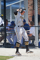 GCL Pirates first baseman Mason Martin (22) celebrates as he returns to the dugout after hitting a home run in the top of the eighth inning, his second of the game, during a game against the GCL Blue Jays on July 20, 2017 at Bobby Mattick Training Center at Englebert Complex in Dunedin, Florida.  GCL Pirates defeated the GCL Blue Jays 11-6 in eleven innings.  (Mike Janes/Four Seam Images)