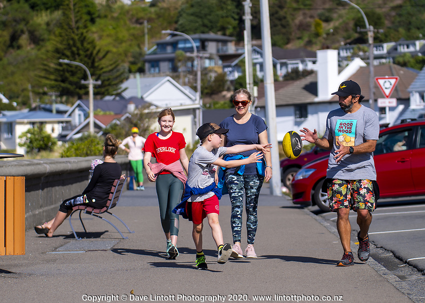 The Dunn family, from left, Rosie, Eddie, Finola and Tom, at Lyall Bay beach on Easter Monday during lockdown for the COVID19 pandemic in Wellington, New Zealand on Monday, 13 April 2020. Photo: Dave Lintott / lintottphoto.co.nz