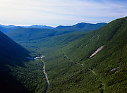 Crawford Notch from Mount Willard in the White Mountains, New Hampshire. Mount Willey can be seen on the right. The route of the old Maine Central Railroad and Route 302 are in view.