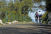 Two cyclists on a paved footpath, Gibraltar.
