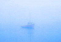 Lone boat on misty still water, Osterville, Cape Cod, MA