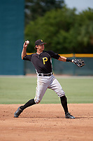 Pittsburgh Pirates shortstop Robbie Glendinning (10) warmup throw to first base during an Instructional League intrasquad black and gold game on October 6, 2017 at Pirate City in Bradenton, Florida.  (Mike Janes/Four Seam Images)