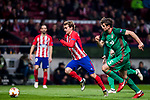 Antoine Griezmann (L) of Atletico de Madrid is followed by Mikhail Lysov and Nemanja Pejcinovic of FC Lokomotiv Moscow during the UEFA Europa League 2017-18 Round of 16 (1st leg) match between Atletico de Madrid and FC Lokomotiv Moscow at Wanda Metropolitano  on March 08 2018 in Madrid, Spain. Photo by Diego Souto / Power Sport Images