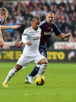 Saturday 19 January 2013<br /> Pictured L-R: Wayne Routledge of Swansea against Jonathan Walters of Stoke<br /> Re: Barclay's Premier League, Swansea City FC v Stoke City at the Liberty Stadium, south Wales.