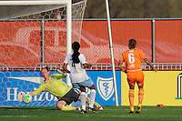 Natasha Kai (6) of Sky Blue FC scores past the diving goalkeeper Jillian Loyden (1) of the Chicago Red Stars. Sky Blue FC defeated the Chicago Red Stars 1-0 in a Women's Professional Soccer (WPS) match at Yurcak Field in Piscataway, NJ, on April 11, 2010.