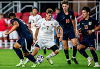 WASHINGTON, DC - SEPTEMBER 6: Maryland forward Hunter George (7) dribbles through the Virginia defense during a game between University of Virginia and University of maryland at Audi Field on September 6, 2021 in Washington, DC.