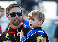 Sep 5, 2016; Clermont, IN, USA; NHRA top fuel driver Morgan Lucas with son Hunter Lucas during the US Nationals at Lucas Oil Raceway. Mandatory Credit: Mark J. Rebilas-USA TODAY Sports