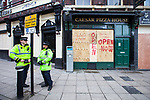 © Joel Goodman - 07973 332324 . 02/04/2011 . Blackburn , UK . Local shops and restaurants board up their windows . The English Defence League ( EDL ) hold a demonstration in Blackburn . Photo credit : Joel Goodman