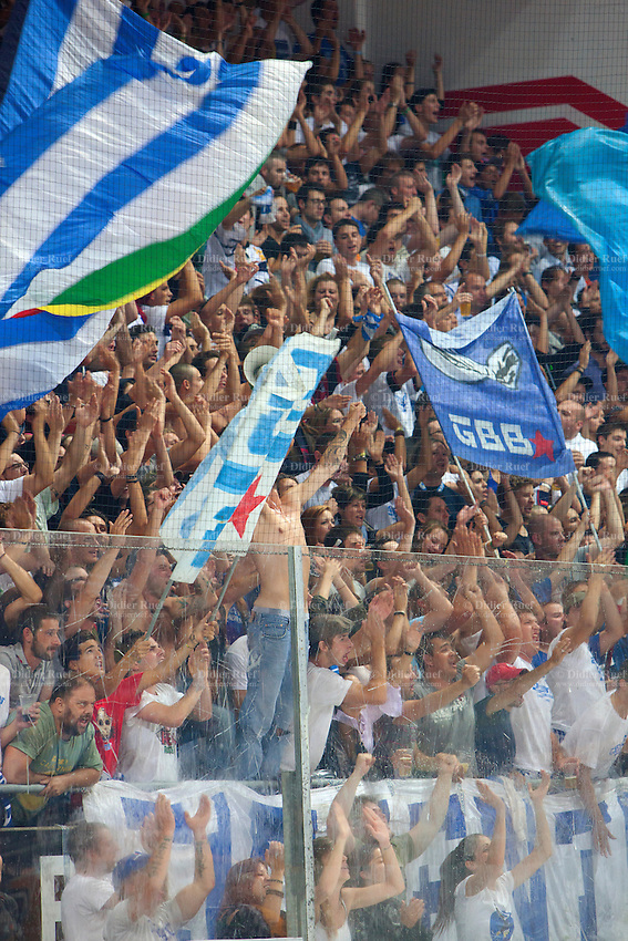 """Switzerland. Lugano. La Resega. Curva Sud. Supporters and Fan Club from Hockey Club Ambrì-Piotta, also known as """"Bianco-Blu"""" (English: white and blue). The hockey fans cheer a goal againt his rival opponent Hockey Club Lugano, often abbreviated to HC Lugano or HCL, which is a professional ice hockey club based in Lugano. The ice rink """" La Resega"""" is an arena, primarily used for ice hockey and is the home arena of Hockey Club Lugano. 24.09.13 © 2013 Didier Ruef"""