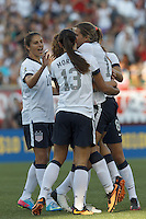 In an international friendly, the U.S. Women's National Team (USWNT) (white/blue) defeated Korea Republic (South Korea) (red/blue), 4-1, at Gillette Stadium on June 15, 2013.