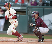 Arkansas second baseman Robert Moore singles Wednesday, April 7, 2021, to drive in third baseman Cullen Smith during the eighth inning of the Razorbacks' 10-3 win over UALR at Baum-Walker Stadium in Fayetteville. Visit nwaonline.com/210408Daily/ for today's photo gallery. <br /> (NWA Democrat-Gazette/Andy Shupe)