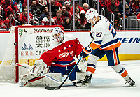 WASHINGTON, DC - JANUARY 31: Braden Holtby #70 of the Washington Capitals  stops a point blank shot from Anders Lee #27 of the New York Islanders during a game between New York Islanders and Washington Capitals at Capital One Arena on January 31, 2020 in Washington, DC.