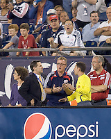 New England Revolution head coach Steve Nicol discusses red card ejection with the fourht official. The Kansas City Wizards  defeated New England Revolution, 4-2, at Gillette Stadium on September 5, 2009.