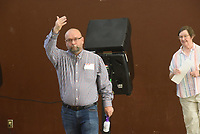 Rodney Fry, poll worker, directs voters to voting machines on Tuesday Sept. 14 2021 during the sales tax election in Pea Ridge. Go to nwaonline.com/210915Daily/ to see more photos.<br />(NWA Democrat-Gazette/Flip Putthoff)