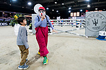 A clown plays with a kid before the Maserati Masters Power during the Longines Masters of Hong Kong at AsiaWorld-Expo on 10 February 2018, in Hong Kong, Hong Kong. Photo by Diego Gonzalez / Power Sport Images