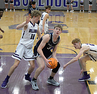 Bentonville West's Dawson Price (3) attempts a shot in the lane Tuesday, Jan. 5, 2021, as he is pressured by Fayetteville's Paiden Pope (11) and Will Yoakley (right) during the first half of play in Bulldog Arena in Fayetteville. Visit nwaonline.com/210106Daily/ for today's photo gallery. <br /> (NWA Democrat-Gazette/Andy Shupe)