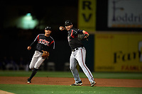 Lake Elsinore Storm third baseman Hudson Potts (15) makes a throw to first base in front of shortstop Kelvin Melean (17) during a California League game against the Rancho Cucamonga Quakes at LoanMart Field on May 19, 2018 in Rancho Cucamonga, California. Lake Elsinore defeated Rancho Cucamonga 10-7. (Zachary Lucy/Four Seam Images)