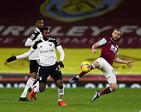 17th February 2021; Turf Moor, Burnley, Lanchashire, England; English Premier League Football, Burnley versus Fulham; Andre-Frank Zambo Anguissa of Fulham competes for the ball with Jay Rodriguez of Burnley