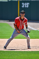 Tommy Medica (24) of the El Paso Chihuahuas on defense against the Salt Lake Bees in Pacific Coast League action at Smith's Ballpark on July 26, 2015 in Salt Lake City, Utah. El Paso defeated Salt Lake 6-3 in 10 innings. (Stephen Smith/Four Seam Images)