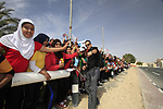 Local school children out in force to cheer on Sky Team and Press Officer Nick Howes before the start of the 3rd Stage of the 2012 Tour of Qatar running 146.5km from Dukhan Souq, Dukhan to Al Gharafa, Qatar. 7th February 2012.<br /> (Photo Eoin Clarke/Newsfile)