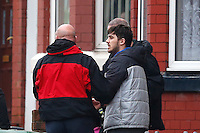 "Pictured: David Campbell (also known as David Charmers in grey coat with black sleeves) is being led away by officers from a house in Raffles Road in Birkenhead, Merseyside, where armed police have placed a containment on a terraced house.<br /> Re: Armed police have been called to a disturbance at a house on Merseyside.<br /> A large number of officers have surrounded the home in Raffles Road, Birkenhead and have closed the road to traffic.<br /> Merseyside Police described the situation as an ""ongoing police incident"" but declined to give further details.<br /> A force spokesman confirmed police arrived at about 08:10am. An ambulance is also in attendance."