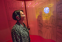 """Ausstellung """"Dialog mit der Zeit"""" im Museum fuer Kommunikation in Berlin-Mitte.<br /> Vom 1. April bis 23. August 2015 werden in der Ausstellung die Facetten des Alters und der Alterns erlebbar gemacht.<br /> Bundespraesident Joachim Gauck eroeffnete die Ausstellung am 31. Maerz 2015 mit einem Rundgang und einer Rede zu neuen Altersbildern in einer Gesellschaft des laengeren Lebens.<br /> Im Bild: Gudrun Loebert (geschrieben mit oe), 72. Sie ist eine der """"Senior-Guides"""" der Ausstellung.<br /> 31.3.2015, Berlin<br /> Copyright: Christian-Ditsch.de<br /> [Inhaltsveraendernde Manipulation des Fotos nur nach ausdruecklicher Genehmigung des Fotografen. Vereinbarungen ueber Abtretung von Persoenlichkeitsrechten/Model Release der abgebildeten Person/Personen liegen nicht vor. NO MODEL RELEASE! Nur fuer Redaktionelle Zwecke. Don't publish without copyright Christian-Ditsch.de, Veroeffentlichung nur mit Fotografennennung, sowie gegen Honorar, MwSt. und Beleg. Konto: I N G - D i B a, IBAN DE58500105175400192269, BIC INGDDEFFXXX, Kontakt: post@christian-ditsch.de<br /> Bei der Bearbeitung der Dateiinformationen darf die Urheberkennzeichnung in den EXIF- und  IPTC-Daten nicht entfernt werden, diese sind in digitalen Medien nach §95c UrhG rechtlich geschuetzt. Der Urhebervermerk wird gemaess §13 UrhG verlangt.]"""