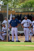 FIU Panthers head coach Mervyl Melendez and infielder Danny Perez (35) during a game against the South Dakota State Jackrabbits on February 23, 2019 at North Charlotte Regional Park in Port Charlotte, Florida.  South Dakota defeated FIU 4-3.  (Mike Janes/Four Seam Images)