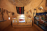 "Pictures of the beehive adobe buildings of Harran, south west Anatolia, Turkey.  Harran was a major ancient city in Upper Mesopotamia whose site is near the modern village of Altınbaşak, Turkey, 24 miles (44 kilometers) southeast of Şanlıurfa. The location is in a district of Şanlıurfa Province that is also named ""Harran"". Harran is famous for its traditional 'beehive' adobe houses, constructed entirely without wood. The design of these makes them cool inside. 1"