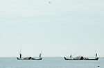 India, Kerala, Backwaters. Working indian men on their boat (punt) in the backwaters between Kollam to Allepey.