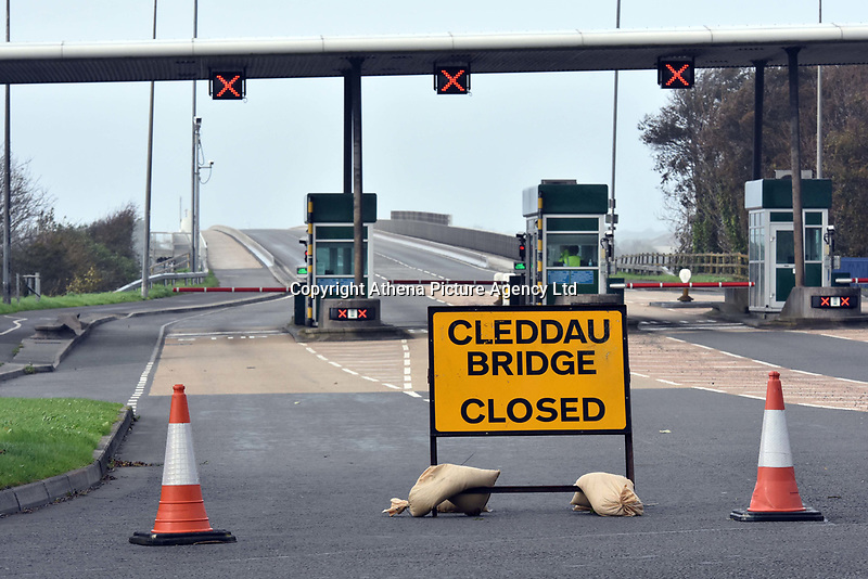 """Pictured: Cleddau Bridge is shut because of strong winds near Pembroke Dock, west Wales. Monday 16 October 2017<br /> Re: Remnants of Hurricane Ophelia are expected to bring strong gusts of wind to Wales when it hits Britain's shores.<br /> The hurricane, making its way from the Azores in the Atlantic Ocean, will have weakened to a storm when it arrives.<br /> A Met Office amber """"be prepared"""" warning has been issued in some areas bringing """"potential danger to life""""."""
