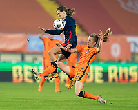 BREDA, NETHERLANDS - NOVEMBER 27: Tobin Heath #17 of the USWNT fights for the ball with Lynn Wilms #15 of the Netherlands during a game between Netherlands and USWNT at Rat Verlegh Stadion on November 27, 2020 in Breda, Netherlands.