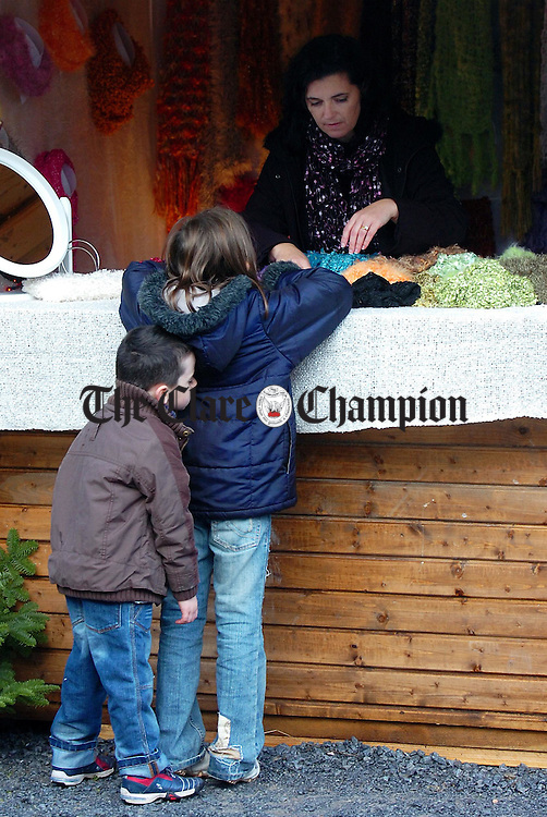 Tiring work for Tadgh O'Reilly 5 and his sister Emer ,9, as they help set out their Mothers stall at the Ballyvaughan Christmas Market on Saturday morning.Pic Arthur Ellis.