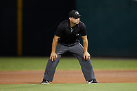 First base umpire Jonathan Parra works the Triple-A East game between the Norfolk Tides and the Charlotte Knights at Truist Field on August 18, 2021 in Charlotte, North Carolina. (Brian Westerholt/Four Seam Images)