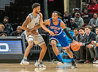 WASHINGTON, DC - DECEMBER 28: Stacy Beckton JR. #2 of American dribbles past Jahvon Blair #0 of Georgetown. during a game between American University and Georgetown University at Capital One Arena on December 28, 2019 in Washington, DC.