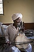 75-year-old Manganiyar artist, Saqar Khan plays his Kamancha (music instrument) inside his house in Hamira village of Jaiselmer district in Rajasthan, India. Photo: Sanjit Das/Panos