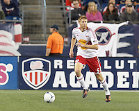 New York Red Bulls defender Markus Holgersson (5) brings the ball forward. Despite a red-card man advantage, in a Major League Soccer (MLS) match, the New England Revolution tied New York Red Bulls, 1-1, at Gillette Stadium on September 22, 2012.