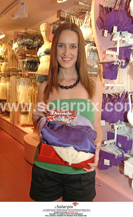 PICTURES FROM SOLARPIX.COM..Viv Benson, employee of Jacqueline Gold of Ann Summers at the Valencian store pictured carrying out tasks set by Jacqueline during the filming of the the brand new LivingTV Show Break with the Boss...DATE: 13/10/2006-JOB REF: 2920-ITS