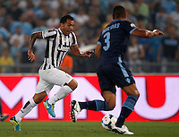 Calcio, Supercoppa di Lega: Juventus vs Lazio. Roma, stadio Olimpico, 18 agosto 2013.<br /> Juventus forward Carlos Tevez, of Argentina, is challenged by Lazio defender Andre Dias, of Brazil, right, during the Italian League Supercup football final match between Juventus and Lazio, at Rome's Olympic stadium,  18 August 2013.<br /> UPDATE IMAGES PRESS/Isabella Bonotto