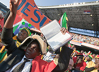 """Two Ghana fans hold up the bible and signs saying """"Believe in Jesus""""   before the 2010 World Cup first round match between Serbia and Ghana at Loftus Versfeld Stadium in Pretoria, South Africa on Saturday, June 12, 2010."""
