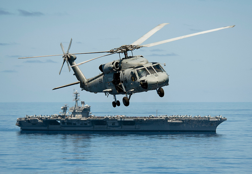 120520-N-DR144-525.PACIFIC OCEAN (May 20, 2012) An SH-60F Sea Hawk helicopter assigned to Helicopter Anti-Submarine Squadron (HS) 15 flies past the Nimitz-class aircraft carrier USS Carl Vinson (CVN 70) during an air power demonstration for embarked tiger cruise participants. Carl Vinson and Carrier Air Wing (CVW) 17 are underway on a tiger cruise after completing a deployment to the U.S. 5th and 7th Fleet areas of operations. (U.S. Navy photo by Mass Communication Specialist 2nd Class James R. Evans/Released).