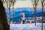 A girl takes a photo during a snowy day in Istanbul, Turkey, on January 18, 2021. Photo by Atia Darwish