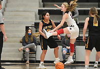 Pea Ridge forward Blakelee Winn (22) blocks Prairie Grove forward Arianna Harrel (21), Friday, January 8, 2021 during a basketball game at Pea Ridge High School in Pea Ridge. Check out nwaonline.com/210108Daily/ for today's photo gallery. <br /> (NWA Democrat-Gazette/Charlie Kaijo)