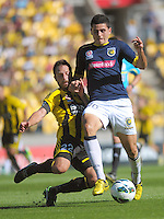 Andrew Durante tackles Tomas Rogic during the A-League football round 12 match between Wellington Phoenix and Central Coast Mariners at Westpac Stadium, Wellington, New Zealand on Saturday, 22 December 2012. Photo: Dave Lintott / lintottphoto.co.nz