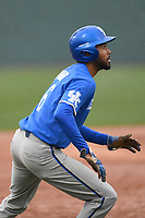 Left fielder Tristan Pompey (6) of the Kentucky Wildcats takes a lead off third base in a game in the rain against the University of South Carolina Upstate Spartans on Saturday, February 17, 2018, at Cleveland S. Harley Park in Spartanburg, South Carolina. Kentucky won, 6-5, in 10 innings. (Tom Priddy/Four Seam Images)