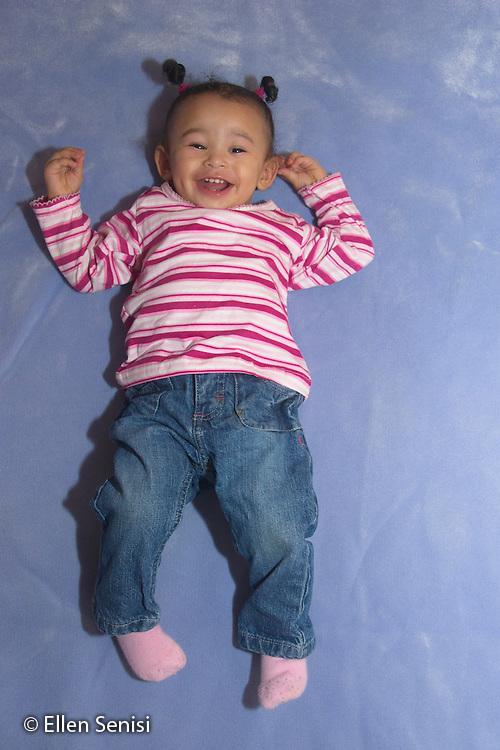 MR / Schenectady, NY. Full-body portrait of infant (girl, 12 months, African American & Caucasian). MR: Dal4. ID: AL-HD. © Ellen B. Senisi