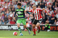 Orion Romeu and Ki Sung-Yueng during the Barclays Premier League match between Southampton v Swansea City played at St Mary's Stadium, Southampton