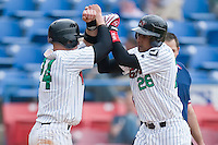 Anderson Gomez (26) of the Winston-Salem Warthogs celebrates with teammate Billy Killian (24) after hitting a 2-run home run versus the Frederick Keys at Ernie Shore Field in Winston-Salem, NC, Sunday, April 20, 2008.