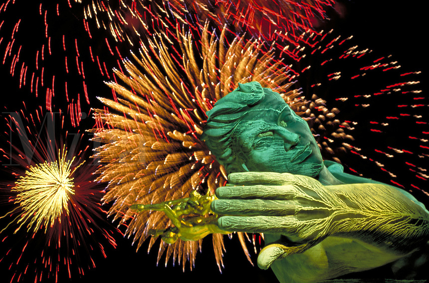 """annual Independence Day celebration fireworks display behind """"""""Spirit of Detroit"""""""" statue by local sculptor Marshall Fredericks at City-County Building. Detroit Michigan USA downtown."""