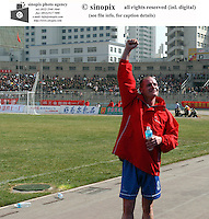 Football fans cheer for Paul Gascoigne during the game between Gansu Tianma and celebrates teammate Hao Long after the game bwtween Qingdao Hailifeng  in  Lanzhou, the capital of China's north-west Gansu province. Tianma won 2-0 at the match.<br />