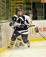 11 February 2011: University of New Hampshire Wildcat defenseman Bryanna Farris, a Sophomore from Carleton Place, Ontario, in action against the University of Vermont Catamounts at Gutterson Fieldhouse in Burlington, Vermont. The Lady Catamounts defeated the visiting Lady Wildcats 4-2 in Hockey East play. Mandatory Credit: Ed Wolfstein Photo